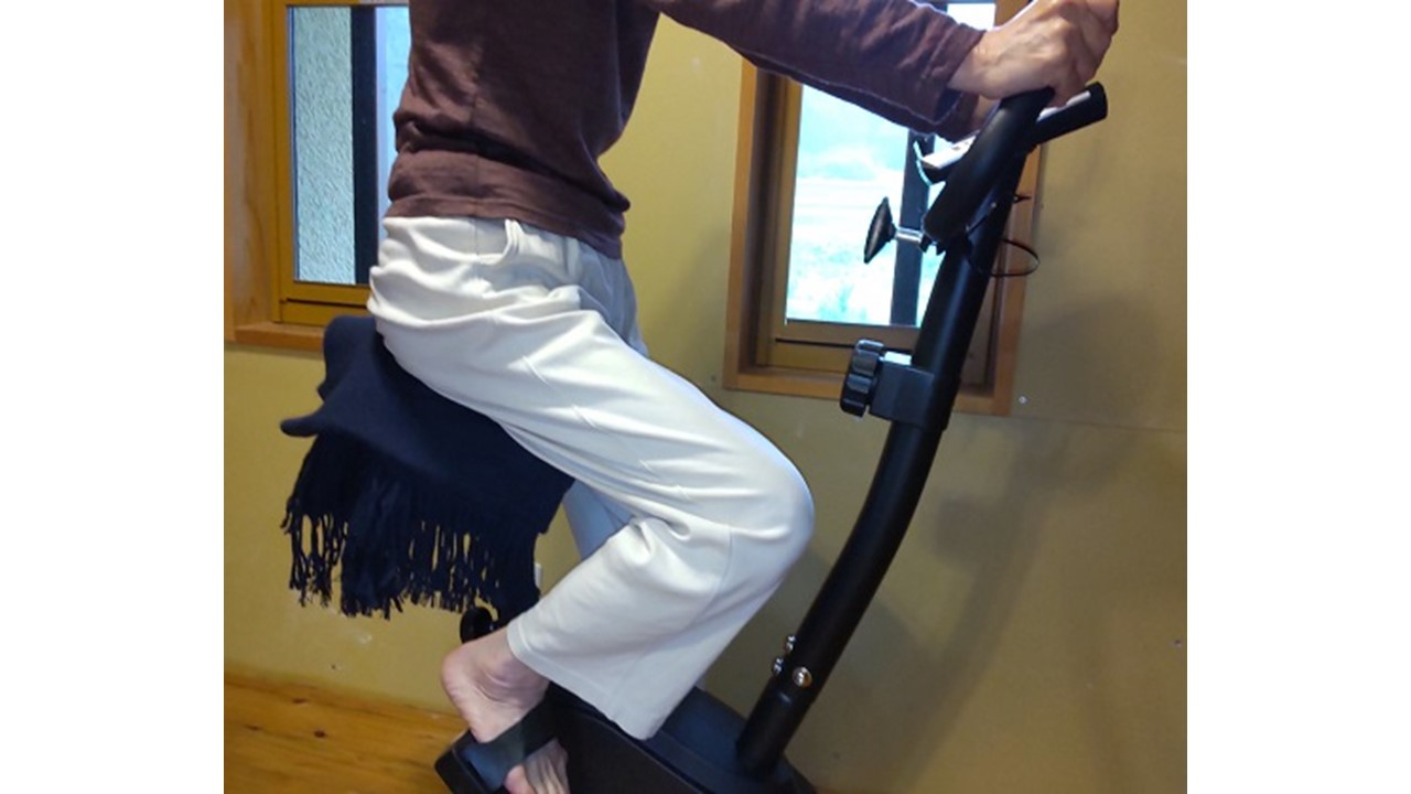 Rowing an exercise bike